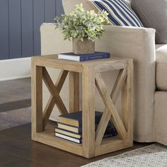 Featuring simple X-supports and a casual, driftwood finish, this cube side table is endlessly versatile.