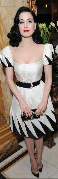 Who made  Dita Von Teese's white dress and black pumps that she wore in London on November 28, 2012?
