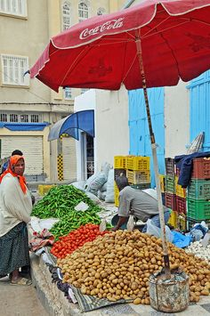 Africa: Amazigh berbers at the local market, Tunisia Carthage, Parasols, Umbrellas, World Street, Traditional Market, African Countries, Flower Market, People Of The World, North Africa
