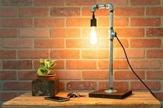 Illuminate your work space or living area with this stunning desk lamp.  #DeskLamp #PipeLamp #IndustrialDecor #UrbanDecor #HandCrafted #GrainAndForge