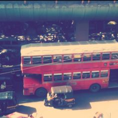 A busy doubledeck bus in highly congested road in mumbai