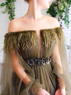 Details - Olive green color - Tulle fabric and feathers around the shoulders - A-line shape with waist definition and long sleeves - For special occasions Green Gown, Olive Green Dresses, Pretty Dresses, Beautiful Dresses, Evening Dresses, Prom Dresses, Fairytale Dress, Haute Couture Gowns, Feather Dress