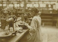 15 year old girl operating a buttonhole machine  In the Dutch shoe factory Jan van Arendonk, The Netherlands,Tilburg, 1928