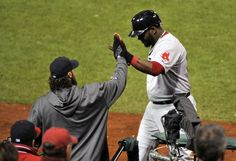 CrowdCam Hot Shot: Boston Red Sox first baseman David Ortiz celebrates with catcher Jarrod Saltalamacchia after scoring against the St. Louis Cardinals during the fifth inning of game four of the MLB baseball World Series at Busch Stadium. Photo by Rob Grabowski