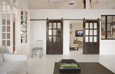 Smart alternative to pocket doors. These sliding barn doors add a super rustic/industrial feel to any home.