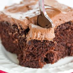 Chocolate Dump-It Cake: An old-fashioned recipe for chocolate cake mixed together in one pot, topped with a tangy cream cheese-chocolate frosting.