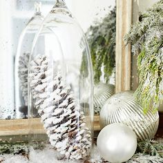 Use an upside down wine glass to show off small ornaments