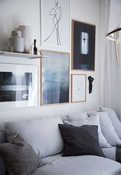 My Scandinavian Home's stunning layered yet minimalist living room   wall gallery adds a personal touch to the space   light grey linen sofa   IKEA Söderhamn sofa with a Bemz Loose Fit Urban cover in Silver Grey Rosendal linen