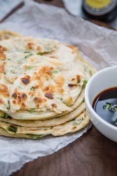 Chewy, flaky, and savory scallion pancakes Recipe. They're one of your favorite Chinese restaurant treats, so why not make them homemade?! A stack of these tasty pancake treats are a lot more easy to make than you might think. Step by step instructions with photos make this flatbread SO SIMPLE to make.