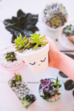 Adorable white planter with a drawn on face! Easy planter DIY!