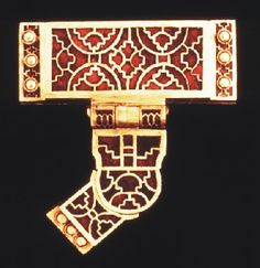 This T-shaped mount provided the link between the lower scabbard suspension strap and the sword belt (British Museum). ~ Sutton Hoard