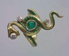 """PAUL BRIANCON, Art Nouveau Snake Ring -   Gold Enamel Emerald Diamond - French, c.1900 -  """"The snake is emblematic of the fin-de-siecle with its decadence and it embodies a cultural history going back to Antiquity with its varied symbolism relating to eternity, sexuality and danger. The serpent with its complex and ambiguous nature fascinated the Symbolists. """""""