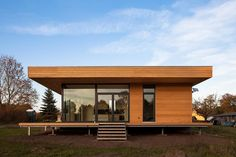 Cost-efficient building with wood in the countryside of the district Oberhavel by Peter Ruge Architekten GmbH - Germany
