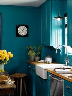 Bright blue walls and a farmer's sink