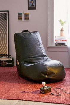 Up your gaming game with this sleek leather-look chair with an ergonomic shape and supportive bean fill. Finished with pouches at the side for stowing remotes + phones plus a carry handle at the top for easily transporting from room to room. Blue Dining Room Chairs, Leather Dining Room Chairs, Accent Chairs For Living Room, Formal Living Rooms, Urban Outfitters Furniture, Cool Furniture, Furniture Design, Uo Home, Bean Bag Sofa