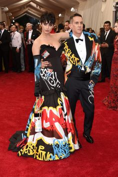 "Katy Perry in Moschino. Katy Perry, with her date and dress designer Jeremy Scott, is wearing a gown straight off his recent runway show. She completed the graffiti look wearing her ""Kris Jenner"" wig. Jeremy Scott, American Idol, Rock Dress, Divas, Katy Perry Hot, Jennifer Lopez Dress, Red Gowns, Gala Dresses, Costume Institute"