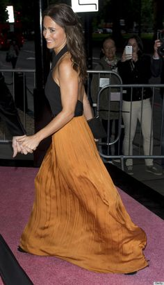 Pippa looking radiant in a black halter gown with a marigold skirt by Catherine Deane, at the Boodles Boxing Ball