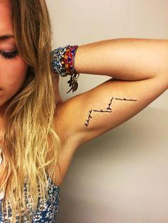 """Dèyè mòn gen mòn.""  ...Beyond mountains, there are mountains.  inner arm tattoo girl"