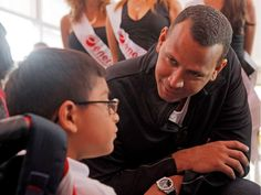 ALEX RODRIGUEZ THROUGH THE YEARS: -   Cancun visit -       New York Yankees third baseman Alex Rodriguez talks with a disabled child during his visit at the Children's Rehabilitation Center Teleton in Cancun, Mexico, on Jan. 16, 2014. Rodriguez visited the facility and also promoted a private gym he owns in the city.  - © Victor Ruiz Garcia/Reuters