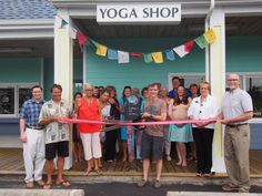 Shiva's Drum Yoga Shop recently opened in Pirates Quay in Nags Head.  The Outer Banks Chamber of Commerce held a ribbon cutting on June 10, 2015 to celebrate this new business providing top American made Yoga fashions from Omgirl, Onzie, Spiritual Gangster and Third Eye Threads as well as performance Yoga clothing from Gaiam and Prana.  Other accessories such as Yoga Mats by Manduka, Jade and Gaiam are also available along with jewelry, pendants, prayer flags, meditation cushions and drums.