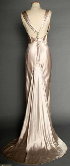"""SILVER SATIN EVENING GOWN, 1930s Pale lavender/silver silk charmeuse, bias-cut, sleeveless, cowl neckline, open back, jeweled Deco elements on shoulder straps & at CB, floating trained back panel, labeled """"NRA Code, Made Under Dress Code Authority PHB038577"""" by winnie"""