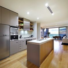 Kitchen that leads your eye out sliding glass doors to a view of Hobson's Bay in Melbourne, Australia. Credit to agents: Kayne Lanyon and Sarah Wood of Marshall White.