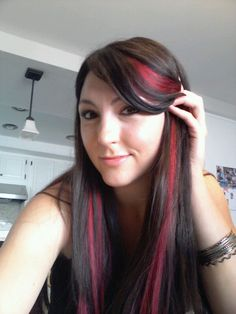 Dark brown hair with pink streaks