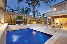 A fully tiled and lit pool with a water feature - tranquil!