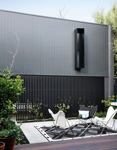 This minimalist home designed the Elwood Townhouse, a private residence with yoga studio located in Elwood, Australia. House Cladding, Exterior Cladding, Facade House, Wall Cladding, Residential Architecture, Architecture Design, Architecture Quotes, Exterior Design, Interior And Exterior