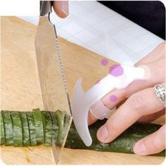 Cutting Knife Ringer Finger Guard Shield - This flexible finger guard helps to protect your fingers while slicing and dicing. The hinged shield bends with natural finger movement. Soft grip rings will fit on right or left handed users.
