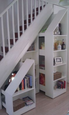 Pull out stair bookcases in white. http://www.arthanfurniture.co.uk/wooden: