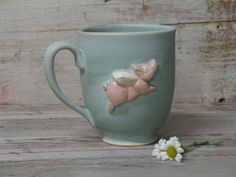 Flying pig coffee cup