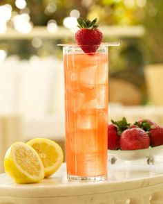 The Strawberry & Grapefruit Collins from the Wynn  1 3/4 oz Finlandia grapefruit vodka 1/2 oz St. Germain Elderflower liqueur 3/4 oz strawberry puree 3/4 oz freshly squeezed and strained lemon juice 3/4 oz simple syrup (recipe below) 2 1/2 oz club soda  Combine ingredients, except for club soda, into a mixing glass.  Add ice and shake to combine. Add club soda to tin.  Strain over fresh ice into a Collins glass. Garnish with a small strawberry. Serve.