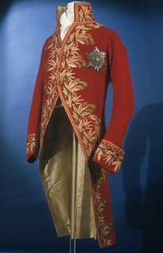 Man's civil uniform coat Wool tabby with silk embroidery Italy 1805 – 1806 The wearer was likely an Italian nobleman from Lombardy, who was a member of the Order of Merit of the Iron Crown. The coat would have been worn with an orange-yellow ribbon of the Order with green borders on the sash across the chest, an Italian light sword of civil pattern, a black bicorne hat and white silk breeches.