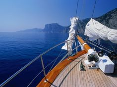 Deck of Yacht Sailing Past Cliffs of Gulf of Orosei, Sardinia, Italy  // By Dallas Stribley