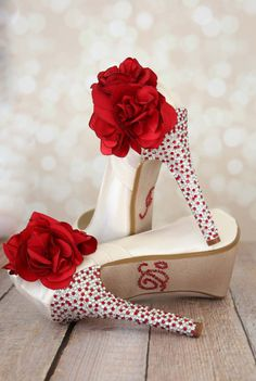 Ivory Wedding Shoes with a red and silver crystal covered heel and a red flower on the ankle.  Custom wedding shoes by Ellie Wren.
