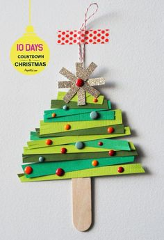 Super fun and easy paper christmas tree ornament craft! Countdown to Christmas! 10 crafts to make the days fly by.  #countdowntochristmas #projectkid