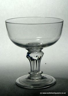 Georgian Pedestal Stem Glass c1740 Crystal glasses from the 18th century. Welcome to scottishantiques.com http://scottishantiques.com/georgian-wine-glasses/pedestal-stem/champagne-coupe1#.VgsP0c5Cm-4