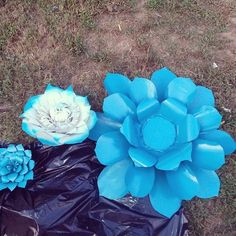 Teal paper flowers handmade with a 100% recycled material.