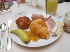 My scrumptious breakfast with croissant, ham, cheese, and pastries at Les Orchidees in the Park Hyatt Paris Vendome where we stayed