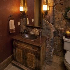 Decorations Interior ~ Fascinating Powder Room Vanity Styles and Remodels: Great Rectangular Mirror Dark Wood Frames Between Simple Wall Light Fixture Over Brown Single Concrete Sink Double Door Powder Room Vanity With Stack Stones Wall Panels Inspiring Country Design