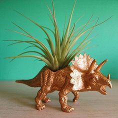 Loving this DIY golden dinosaur planter! Plant Leaves, Dinosaur Stuffed Animal, Moose Art, Planters, Etsy Seller, 1, Creative, Nature, Handmade