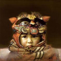 Liu Derun and Li Yan Derun (China) ~ There exists in China, a heart-warming and abiding custom. When a child was expected in the family, the mother or a close relative would personally design, sew and stitch an adorable and impressive-looking Tiger Head Hat. They hoped that by wearing the hat, the child would be protected from evil and disease. The hat also symbolizes continuity and prosperity.
