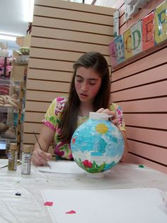 Girl decorating a peace lantern at artbeat
