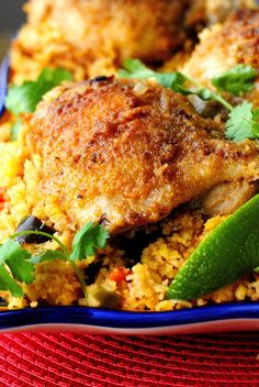 Arroz Con Pollo - 1 Tbs salt, 1 tsp each garlic, paprika, & onion powder; ½ tsp cumin, ½ tsp black pepper, 6 chicken thighs bone in skin on, flour for dredging chicken, ¼ C olive oil. For the Rice: 2 C rice, 1 large seeded & diced poblano pepper, 1 diced onion, 4 cloves minced garlic, 2 C diced tomatoes, 4 C chicken stock, 1 tsp salt, 1 tsp cumin, ½ tsp turmeric, ¼ tsp red pepper flakes. Optional garnish: ½ chop stuffed green spanish olives, rough chop cilantro, lime wedges.