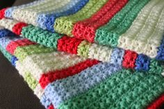 This blanket on the Little Woolie blog makes me think I'd like to use star stitch for a baby blanket in a solid color. Very pretty!