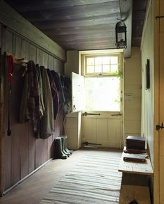 The stable side entrance... this would work too... hooks without bench in front of them (easier to reach) w long bench on other side... low hooks needed somewhere