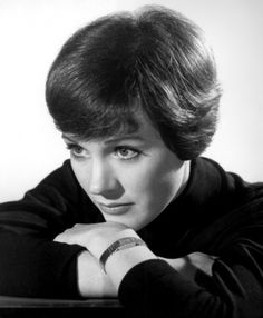 Julie Andrews.  She's my hero!  Hearing her sing in the old movies makes my heart swell! =)