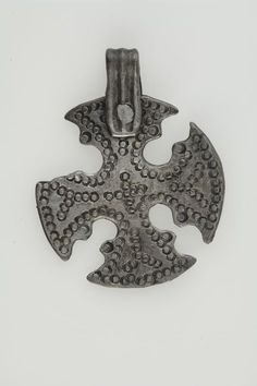 https://flic.kr/p/btZF8K | Pendant, cross shaped | Pendant, cross shaped. Silver. The pendant is made from a coin. Grave find, Björkö, Adelsö, Uppland, Sweden.  SHM 34000:Bj 835  See also kulturarvsdata.se/shm/object/html/108343
