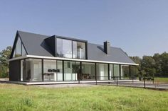 Contemporary bungalow in the Netherlands. Traditional shape but looks completely contemporary